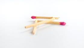 Due grandi partite rotte con la testa di partita rosa su fondo bianco Fotografia Stock Libera da Diritti