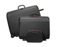 Due grandi valigie e sacchetti di corsa Immagini Stock