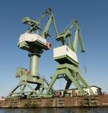 Due gru in un porto Fotografia Stock Libera da Diritti