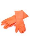 Due guanti di gomma arancio isolati Fotografia Stock