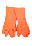 Due guanti di gomma arancio isolati Immagine Stock