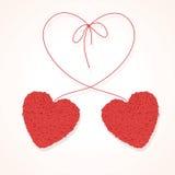 Due hanno annodato le sfere dei filetti nel modulo di cuore illustrazione di stock