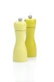 Due laminatoi di pepe gialli fotografia stock libera da diritti
