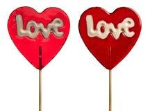 Due lollipops - cuore con i sottotitoli di amore Fotografie Stock Libere da Diritti