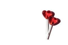 Due Lollipops Due cuori Caramella Concetto di amore Giorno del biglietto di S Immagini Stock Libere da Diritti
