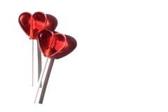Due Lollipops Due cuori Caramella Concetto di amore Giorno del biglietto di S Immagini Stock