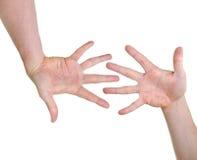 Due mani che indicano compatibilità Fotografia Stock