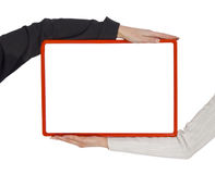 Due mani che tengono blocco per grafici in bianco fotografia stock libera da diritti