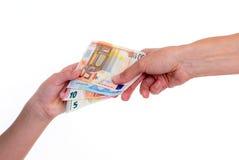Due mani con gli euro soldi Fotografie Stock
