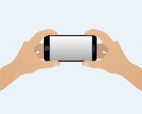 Due mani con uno smartphone orizzontalmente Fotografia Stock