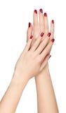 Due mani della donna con l'unghia rossa Fotografia Stock Libera da Diritti