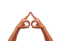Due mani di caucasion stanno sviluppando un simbolo Fotografia Stock