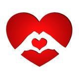 Due mani sopra un cuore rosso Fotografia Stock Libera da Diritti