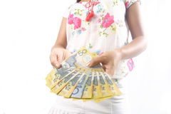 Due mani tenendo i mucchi dei dollari australiani Fotografia Stock Libera da Diritti