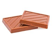 Due mattonelle di cioccolato al latte Fotografia Stock Libera da Diritti