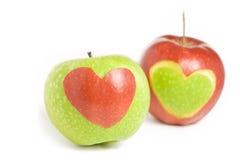 Due mele con cuore Immagine Stock