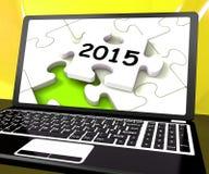 Due mila e quindici sul computer portatile mostrano a nuovi anni la risoluzione  royalty illustrazione gratis