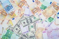 Due monete forti di piombo - dollaro americano e euro Immagini Stock Libere da Diritti