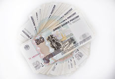 Due pacchetti di 100 banconote dei pezzi 100 cento cinquanta rubli e 50 rubli di banconote della Banca della Russia Fotografie Stock
