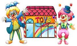 Due pagliacci davanti ad un deposito di giocattolo illustrazione di stock