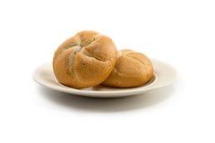 Due panini tondi su un piatto bianchiccio Fotografia Stock