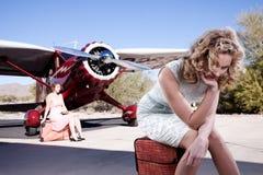 Due passeggeri che aspettano un volo Fotografia Stock