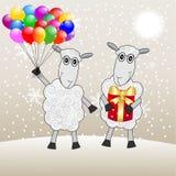 Due pecore allegre con un regalo ed i marmi Fotografie Stock