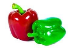 Due peperoni dolci isolati su fondo bianco Fotografie Stock