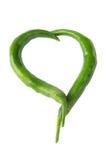 Due peperoni verdi in una figura del cuore Immagini Stock