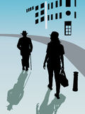 Due persone con camminare del cappello Immagine Stock Libera da Diritti