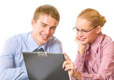 Due persone di affari con il computer portatile Immagini Stock