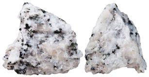 due pezzi di pietra minerale della diorite isolata Immagini Stock