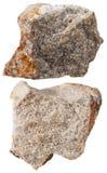 Due pezzi di pietra minerale della quarzite isolata Immagini Stock