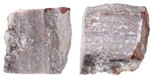Due pezzi di pietra minerale della riolite isolata Fotografie Stock