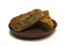 Due pezzi di torta di mele su un piatto Immagine Stock