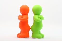 Due piccole genti di plastica Fotografie Stock Libere da Diritti