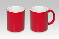 Due posizioni di una tazza rossa fotografie stock