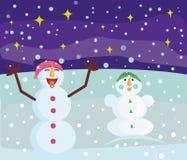 Due pupazzi di neve si rallegrano nella neve immagini stock