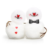 Due pupazzi di neve svegli nell'abbracciare di amore Fotografia Stock