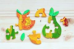 Due puzzle di legno fatti dei pezzi colorati Fotografia Stock Libera da Diritti