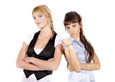 Due ragazze arrabbiate fotografia stock