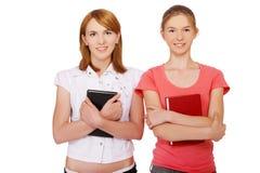 Due ragazze con i libri Immagini Stock