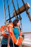 Due ragazze con un lifebuoy Fotografia Stock Libera da Diritti