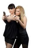 Due ragazze con una pistola Fotografia Stock
