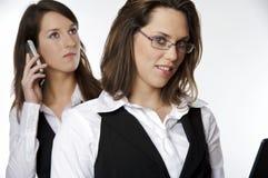 Due ragazze di affari fotografia stock