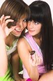 Due ragazze e cioccolato Fotografie Stock
