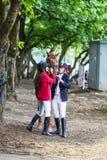 Due ragazze e un cavallo Fotografia Stock
