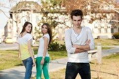 Due ragazze e un ragazzo Immagini Stock