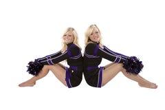Due ragazze pon pon di nuovo alla parte posteriore Fotografie Stock Libere da Diritti