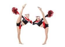 Due ragazze pon pon professionali che propongono allo studio Spaccatura di verticale Fotografie Stock Libere da Diritti